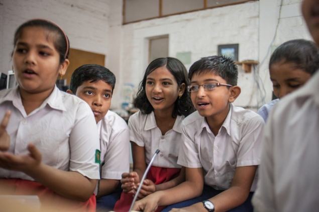A group of students in Karakati, India, research the answer to a big question at one location of Sugata Mitra's School in the Cloud. According to Mitra and Adam Braun, there's a lot that Western schools can learn about education from students in India.